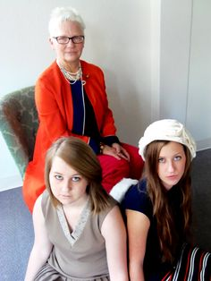 Brown pleated dress, navy/striped dress, orange mod Gay Gibson coat, and white hat