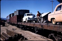 Sally 2 (1956 Morris Minor) on train at Alice Springs ready to depart to Port Augusta 1958. Collected then rapid return to NSW via the rough, dirt road from Broken Hill thence to Sydney - back to work, holiday over.