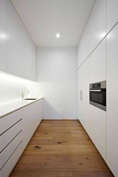 Modern white kitchen by Urban Angles