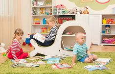 Whale Vilma is bookcase for children that can be used as place to take a seat.