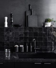 The kitchen has two handmade backsplashes a row of handglazed glossy black Moroccan Clé tile and a bleached metal steel wall surroundan effect Hollis developed wit. Kitchen Wall Tiles, Kitchen Backsplash, Kitchen Shelves, Black Backsplash, Kitchen Black Tiles, Backsplash Ideas, Black Gloss Kitchen, Black Wall Tiles, Kitchen Cabinets