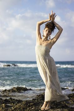 Greek Goddess, maxi beige dress, and geometric earrings