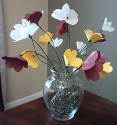 My attempt at Jeffery Rudell's Simple White Paper Flowers. I decided to add a few Fall colored flowers in the mix.I would have preferred to use the light green floral tape, but the craft store...