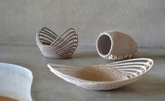 The Siphiwe Collection - The Backbone series includes three pieces: Arc bowl, Arc platter and The Pillar. All are handwoven from natural lutindzi grass and reeds, recycled fabric and discs of cow bone. By Gone Rural.