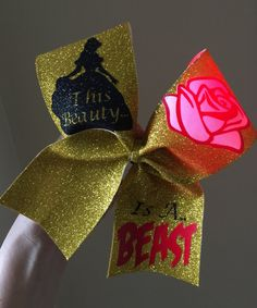 This BEAUTY IS A BEAST LIGHT UP RED ROSE Cheer Bow full gold glitter Beauty and the Beast