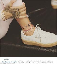 I would totally wear these jawns....... ink: Rihanna has a new tattoo of the year she was born inked onto her ankle