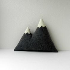 the Peaks -- plush wool mountain pillow, via Etsy.This may go well with the mountain goat stuffed animals you like Kels