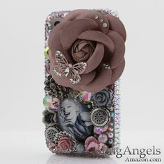 <3 this but it looks heavy as shizzzz lol Amazon.com: 3D Swarovski Crystal Bling Case Cover for iphone 4 4S AT Verizo & Sprint Marilyn Monroe Design (Handcrafted by BlingAngels): Cell Phones & Accessories