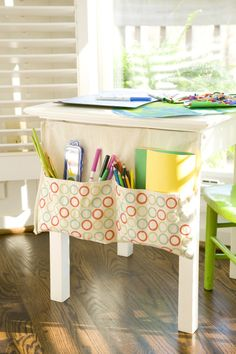 kids art organizer. so clever use a kids apron and attach to table with velcro