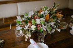 Centerpiece with protea and cactus, magnolia, Clematis, pieres, sage, dusty miller,  cockscomb, and garden roses. Our Love is Loud photography | Beet & Yarrow floral design | Gozo restaurant Denver, CO
