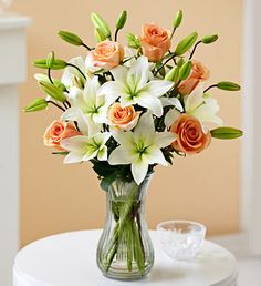 Rose and Lily Bouquet For Wedding, Birthday, Girl Friend, Evening Party and so on. We also can give you the best server at most beautiful flowers Flower Centerpieces, Flower Vases, Flower Decorations, Beautiful Flower Arrangements, Floral Arrangements, Beautiful Flowers, Red Bouquet Wedding, Wedding Flowers, Rose And Lily Bouquet