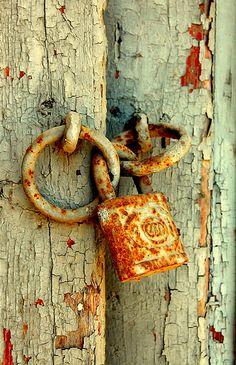 rusty lock by sophia@, via Flickr