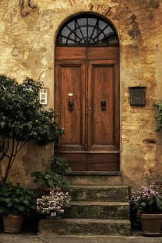 Tuscan door - Entrance to a house in the Tuscan hill town of Pienza, Italy. - Photograph by Andrew Soundarajan