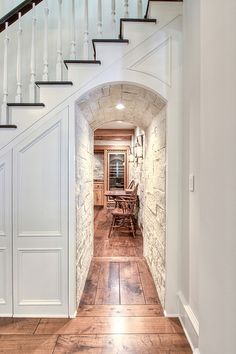 Hall under stairs with brick