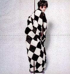 Faye Wong wearing Yohji Yamamoto harlequeen cape, Fall–Winter 1997–1998
