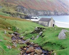 Coastal Country Cottages | This is the Irish Coast. I just love the cottage in the picture too!