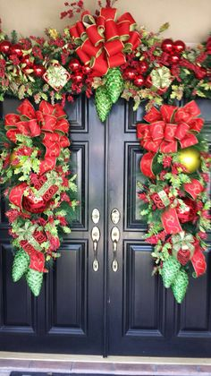 Designed by Rick Butler-Owner of Garden District. Front Door Christmas Decorations, Christmas Front Doors, Christmas Swags, Rustic Christmas, Christmas Home, Christmas Crafts, Holiday Decor, Christmas Interiors, Foyers