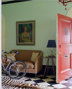 pastel wall, bright door and black floors <3