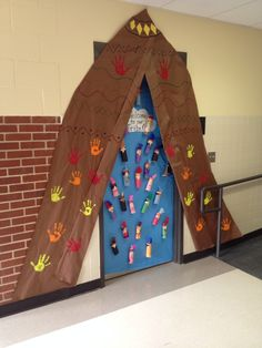 This is the door I did for our door decoration contest in November. The kids loved walking into a Tee-pee!! They had a blast making their Indians and hand prints on the Tee-pee too.