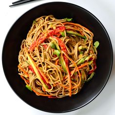 Sesame-ginger soba noodles is a great 30-minute dish. Soba combined with fresh veggies and a simple sesame-ginger sauce. This dish makes a great vegan main.