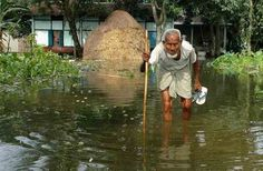 An old man wades through flood water at Bulut village in Kamrup district of Assam on Saturday (PTI) Assam floods, July 2013 Posted by floodlist.com
