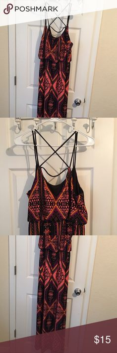Tribal maxi dress Cute pink, black, and yellow tribal style maxi dress. Criss crosses in the back. Charlotte Russe brand. Never worn, only tried on. Dresses Maxi
