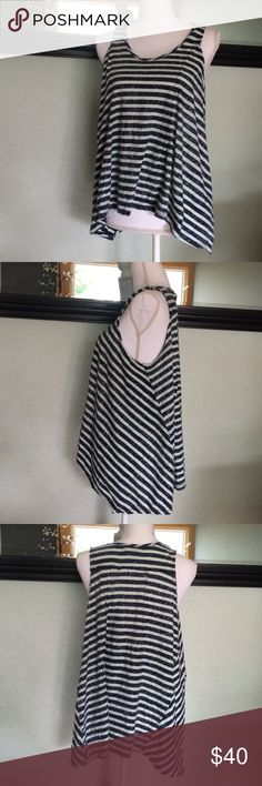 Free people striped tank Adorable striped free people tank. Light blue and navy blue. Shorter in front and longer in the back. Fitted near top then very loose at bottom. Super soft material! Arm pit to arm pit 22. Free People Tops Tank Tops