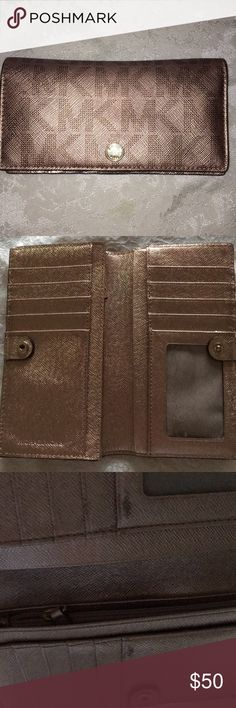 Gently Used MK Rosegold Wallet Gently Used MK Rosegold Wallet Lightly worn see photo Michael Kors Bags Wallets
