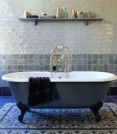 A roundup of baths featuring traditional English manor house plumbing fixtures mixed with Far East influences (Moroccan tile, kilims, carved cabinetry).
