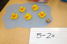 Adding or Subtracting: Ducks in a Pond Word Problems. (Laminate a blue pond on a large green sheet for 5 workmats.)