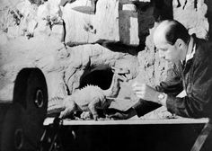 Harryhausen works with a figure of a dragon as a camera rolls.