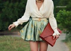 Green skirt and large brown clutch