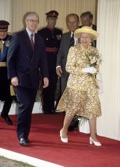 1991: Pictured with former Prime Minister John Major in 1991. He said he was able to open up to the Queen as 'nobody else is present, apart from the occasional corgi'