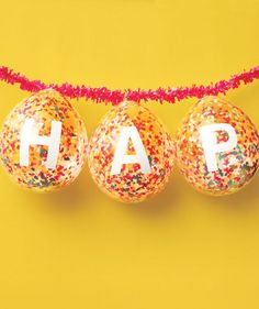 Follow this step-by-step tutorial to craft your own birthday banner out of confetti-filled balloons.