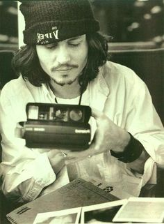 #JohnnyDepp in his 90s #grunge style. Along with a #Polaroid camera.