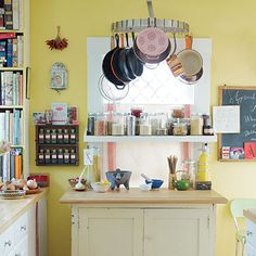 Use a hanging rack for pots and pans and a floating shelf for jarred items