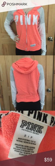 *Rare* VS PINK Zip Up Hoodie Very rare orange, white and grey zip up hoodie. I was only able to find this exact one once selling on eBay for $71. This is pre-owned but still in great condition! Also comes from a smoke free home! 😊 PINK Victoria's Secret Tops Sweatshirts & Hoodies