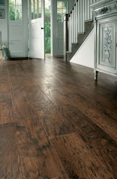 All of the grain and texture of a rustic dark timber with none of the hassle of real wood floors with this Hickory Nutmeg Karndean plank. This intricate and tactile design creates the style of a real antique brown wood floor.