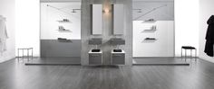 Ambiente Acquabella con platos de ducha a medida Trendy Ardesia, encimeras y mobiliario Mini.