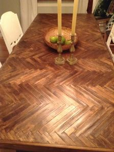 Creating a Herringbone Table from an old door and paint sticks. Amazing!