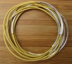Handmade Yellow Leather Cord Bangles With Silver by MaribelleCampa