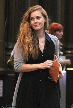 A reason to smile: Amy Adams, 41, was snapped strolling through NYC Tuesday, after returning from a successful outing at the Toronto International Film Festival, where she promoted her upcoming film Arrival