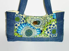 This beautiful quilted recycled denim jean and repurposed yellow, green and blue large floral fabric handbag/purse is truly a unique creation.