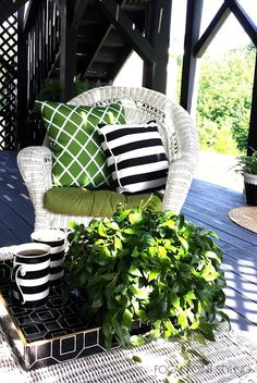 When setting your back porch or deck space, keep it simple: On the coffee table a graphic tray from @homegoods gives a flat surface for a plant & morning coffee (in stripe mugs also from HG!) sponsored pin
