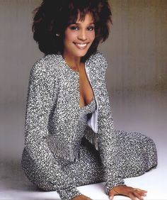 Whitney Houston wearing Marc Bouwer crystal studded printed blackand white jacket and gown