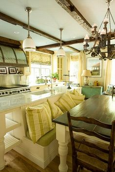 This is how I would to have a kitchen...my family sitting while I finish serving or still talking as I make room for dessert...I love it!!! It's rustic but clean and fresh and modern at the same time!