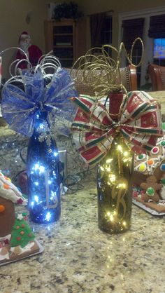 Empty wine bottle with Cmas lights, vinyl letter  decorations at top -or cute decor for teacher gifts