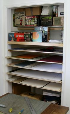 "Flat storage in closet space - studio of artyfakt ""My studio space is too small for flat files, and this cost about 1/10 as much... about $100 in materials -- birch plywood cut to size, and rails along the sides and back wall -- and a few hours of labor."""