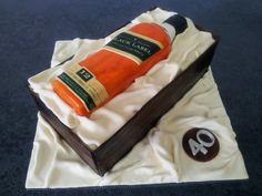 Black label bottle cake and box, all are edible. it's a vanilla cake with dulce de leche filling!!!
