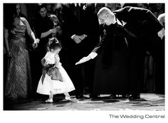 Asking the flower girl to dance... She's so shy! This is stinkin' adorable. XD